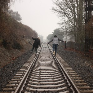 folks on railroad track